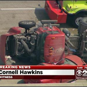 Truck Rolls Over Onto Car, 3 Hurt