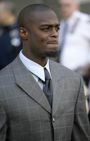 FILE- In this March 31, 2009 file photo, New York Giants football player Plaxico Burress leaves the criminal courts building in New York, where he appeared on illegal gun possession charges. The wide receiver, who had no criminal record, ended up spending nearly two years in prison for possessing an illegal firearm after accidently shooting himself with it at a New York City Nightclub. New York City has some of the Nation's toughest gun laws. (AP Photo/Seth Wenig, File)