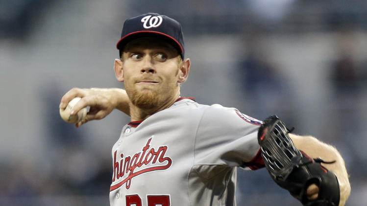 Washington Nationals starting pitcher Stephen Strasburg works against the San Diego Padres in the first inning of a baseball game in San Diego, Thursday, May 16, 2013. (AP Photo/Lenny Ignelzi)