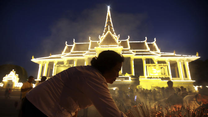 Mourners gather in front of the Royal Palace and light incense sticks as offerings to the late Cambodian King Norodom Sihanouk ahead of his funeral, Thursday, Jan. 31, 2013, in Phnom Penh, Cambodia. The body of Sihanouk who died on Oct. 15, 2012 at age 89, is scheduled to be cremated on Feb. 4, 2013.(AP Photo/Wong Maye-E)