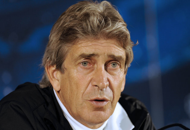 Malaga's coach Manuel Pellegrini, from Chile, attends a news conference before a soccer training session at FC Porto's Dragao stadium in Porto, Portugal, Monday, Feb. 18, 2013. Malaga are due to play 