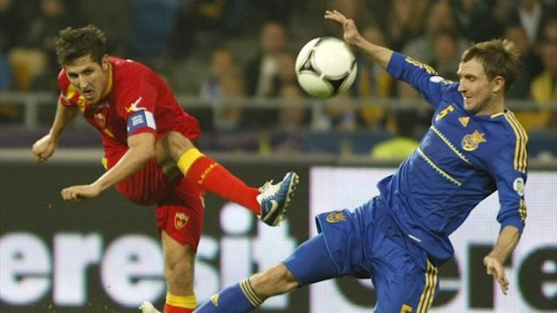 Ukraine's Oleksandr Kucher attempts to block a shot by Montenegro's Stevan Jovetic.