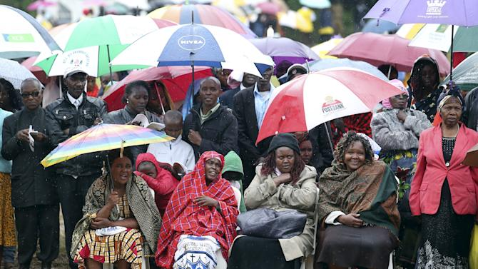 Faithful attend the mass by Pope Francis, as rain falls in Kenya's capital Nairobi
