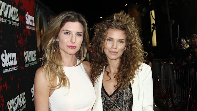 """IMAGE DISTRIBUTED FOR STARZ - Viva Bianca, left, and AnnaLyne McCord arrive at the premiere of """"Spartacus: War of the Damned"""" on Tuesday, Jan. 22, 2013 in Los Angeles. """"Spartacus: War of the Damned"""" premieres Friday, Jan. 25 at 9PM on STARZ. (Photo by Matt Sayles/Invision for STARZ/AP Images)"""