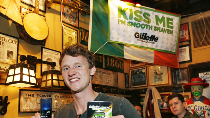 """A pub customer holds up Gillette products after receiving a free shave during the Gillette """"Kiss Me, I'm Smooth Shaven!"""" festivities at McGillin's Ale House, reminding guys to K.I.S.S. - Keep It Smooth Shaven - on Sunday, March 10, 2013 in Philadelphia. A recent study revealed that 85% of women prefer to kiss a man who is smooth shaven, and that two out of three women said men will have better luck with them if they are stubble-free. (Photo by Mark Stehle/Invision for Gillette/AP Images)"""