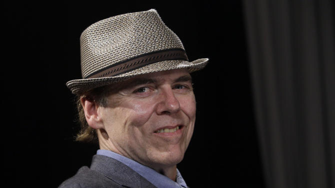 "In this Aug. 16, 2011 photo, singer-songwriter John Hiatt poses for photos, in New York, to promote his latest album, ""Dirty Jeans and Mudslide Hymns.""  (AP Photo/Richard Drew)"