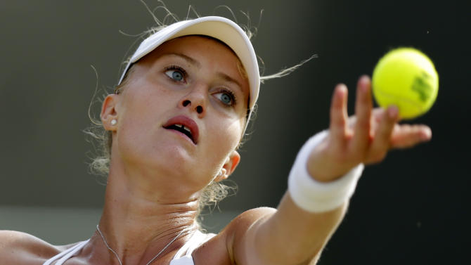 Kristina Mladenovic of France serves during her match against Victoria Azarenka of Belarus at the Wimbledon Tennis Championships in London