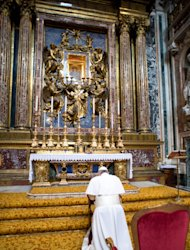CORRECTS YEAR TO 2013 - In this photo provided by the Vatican newspaper L'Osservatore Romano, Pope Francis kneels in prayer in front of the icon of the Virgin Mary inside St. Mary Major Basilica, in Rome, Thursday, March 14, 2013. Pope Francis opened his first morning as pontiff by praying Thursday at Rome's main basilica dedicated to the Virgin Mary, a day after cardinals elected him the first pope from the Americas in a bid to revive a Catholic Church in crisis and give it a preacher with a humble touch. (AP Photo/L'Osservatore Romano, ho)