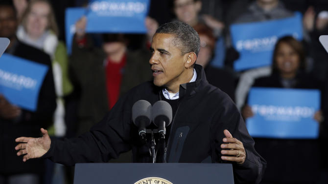 President Barack Obama speaks to supporters during his final campaign stop on the evening before the 2012 election, Monday, Nov. 5, 2012, in Des Moines, Iowa. (AP Photo/Charlie Neibergall)