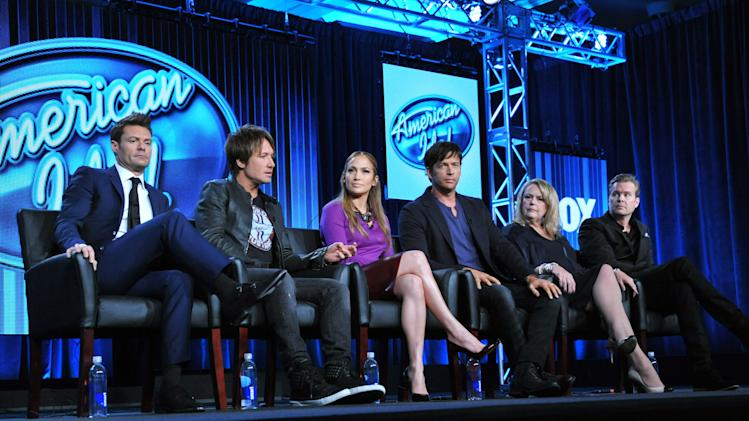 "From left, Host Ryan Seacrest, Judges Keith Urban, Jennifer Lopez, and Harry Connick Jr., and executive producers Trish Kinane and Per Blankens are seen during the panel of ""American Idol"" at the FOX Winter 2014 TCA, on Monday, Jan. 13, 2014, at the Langham Hotel in Pasadena, Calif. (Photo by Richard Shotwell/Invision/AP)"