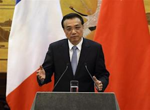 Chinese Premier Li speaks during a news conference with French PM Ayrault in Beijing
