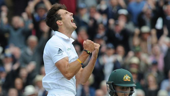 England's Steven Finn, left, celebrates after bowling Australia's Steven Smith, right, caught Alastair Cook for 7 runs during day one of the third Ashes Test cricket match, at Edgbaston, Birmingham, England, Wednesday, July 29, 2015. (AP Photo/Rui Vieira)