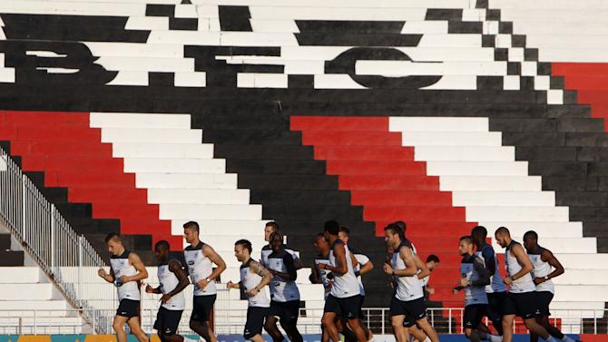 Players of the French national soccer team run on the field during a training session at the Santa Cruz stadium in Ribeirao Preto, Brazil, Sunday, June 22, 2014. Having captured people's attention at the soccer World Cup with some scintillating attacking football, France's players are now in unknown territory after raising expectations back home, having routed Switzerland and Honduras. (AP Photo/David Vincent)