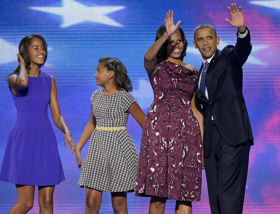 President Barack Obama and First lady Michelle Obama waves to delegates as their daughters Malia and Sasha join them at the Democratic National Convention in Charlotte, N.C., on Thursday, Sept. 6, 2012. (AP Photo/J. Scott Applewhite)