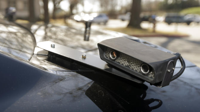 In this photo taken Jan. 16, 2013, a camera is mounted near the rear window of a police car in Little Rock, Ark. The device is part of a system that scans traffic on the streets, relaying the data it collects to a computer for sifting. Police say the surveillance helps identify stolen cars and drivers with outstanding arrest warrants. (AP Photo/Danny Johnston)