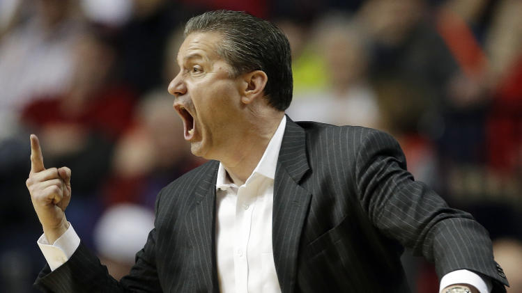 Kentucky head coach John Calipari directs his team during the second half of an NCAA college basketball game against Vanderbilt the Southeastern Conference tournament, Friday, March 15, 2013, in Nashville, Tenn. (AP Photo/Dave Martin)