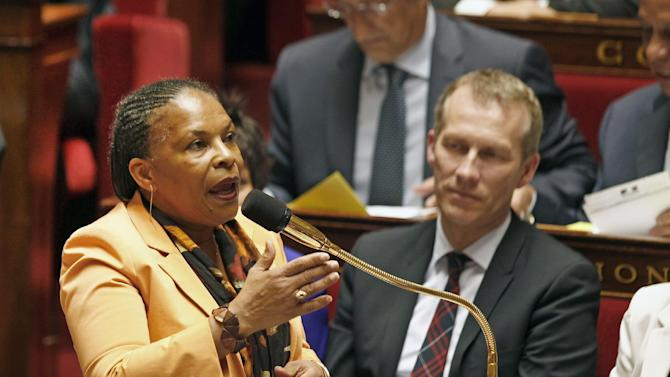 French justice minister Christiane Taubira addresses members of parliament during the questions to the government session, at the National Assembly in Paris, Tuesday April 23, 2013. President Francois Hollande's social reform on gay marriage and adoption have already been approved by both houses of French parliament. The second and final reading is expected today. (AP Photo/Remy de la Mauviniere)