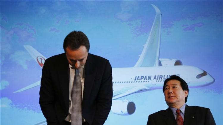 Airbus Chief Executive Bregier bows as Japan Airlines President Ueki looks on during their joint news conference in Tokyo