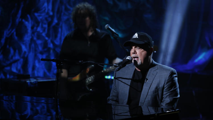 "In this photo provided by NBC, Billy Joel performs during ""Hurricane Sandy: Coming Together"" Friday, Nov. 2, 2012, in New York. Hosted by Matt Lauer, the event is heavy on stars identified with New Jersey and the New York metropolitan area, which took the brunt of this week's deadly storm. (AP Photo/NBC, Heidi Gutman)"