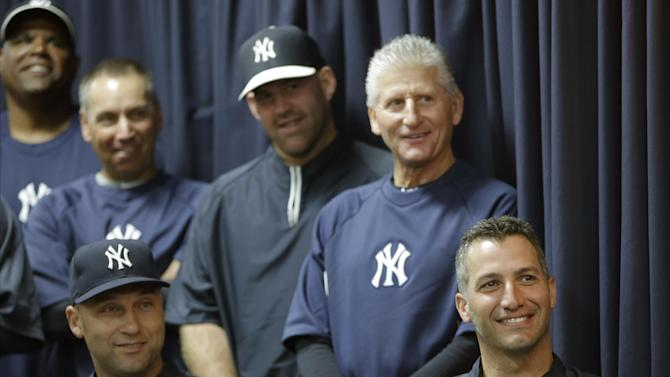 New York Yankees shortstop Derek Jeter, lower left, and pitcher Andy Pettitte, sit with coaches behind them as they watch Mariano Rivera, who holds baseball's all-time saves record, announce his plans to retire at the end of the 2013 season at a news conference at Steinbrenner Field Saturday, March 9, 2013 in Tampa, Fla.  The entire Yankees team showed up to hear the announcement. (AP Photo/Kathy Willens)