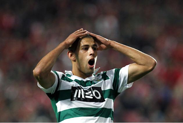 Sporting's Islam Slimani, from Algeria, reacts after missing a chance to score during a Portugal Cup soccer match between Benfica and Sporting at Benfica's Luz stadium in Lisbon, Saturday, Nov. 9, 201