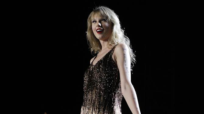 """FILE - In this March 2, 2012 file photo, Taylor Swift performs on stage at the Burswood Dome during the opening night of her """"Speak Now"""" Australian tour in Perth, Australia. Multi-platinum selling superstar Taylor Swift is releasing her fourth studio album called """"Red"""" on Oct. 22. (AP Photo/Theron Kirkman, File)"""