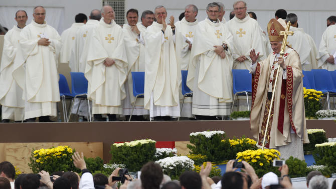 """Pope Benedict XVI waves after celebrating a Mass in Bresso, near Milan, Italy, Sunday, June 3, 2012. Pope Benedict XVI has celebrated an open-air Mass before some 850,000 followers as part of three days of activities in Milan aimed at showing support for families. The pope in his homily Sunday took issue with modern economic thinking that he said """"creates ferocious competition, strong inequalities, degradation of the environment"""" and reduces family relationships """"to fragile convergences of individual interests"""" that undermine the social fabric. (AP Photo/Luca Bruno)"""
