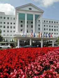 FILE - In this July 31, 2007 file photo, flowers bloom at the entrance to The Greenbrier resort and spa in White Sulphur Springs, W.Va. Historic hotels are facing more competitive pressure, continually trying to engage in new marketing campaigns to attract customers. (AP Photo/Jeff Gentner, File)