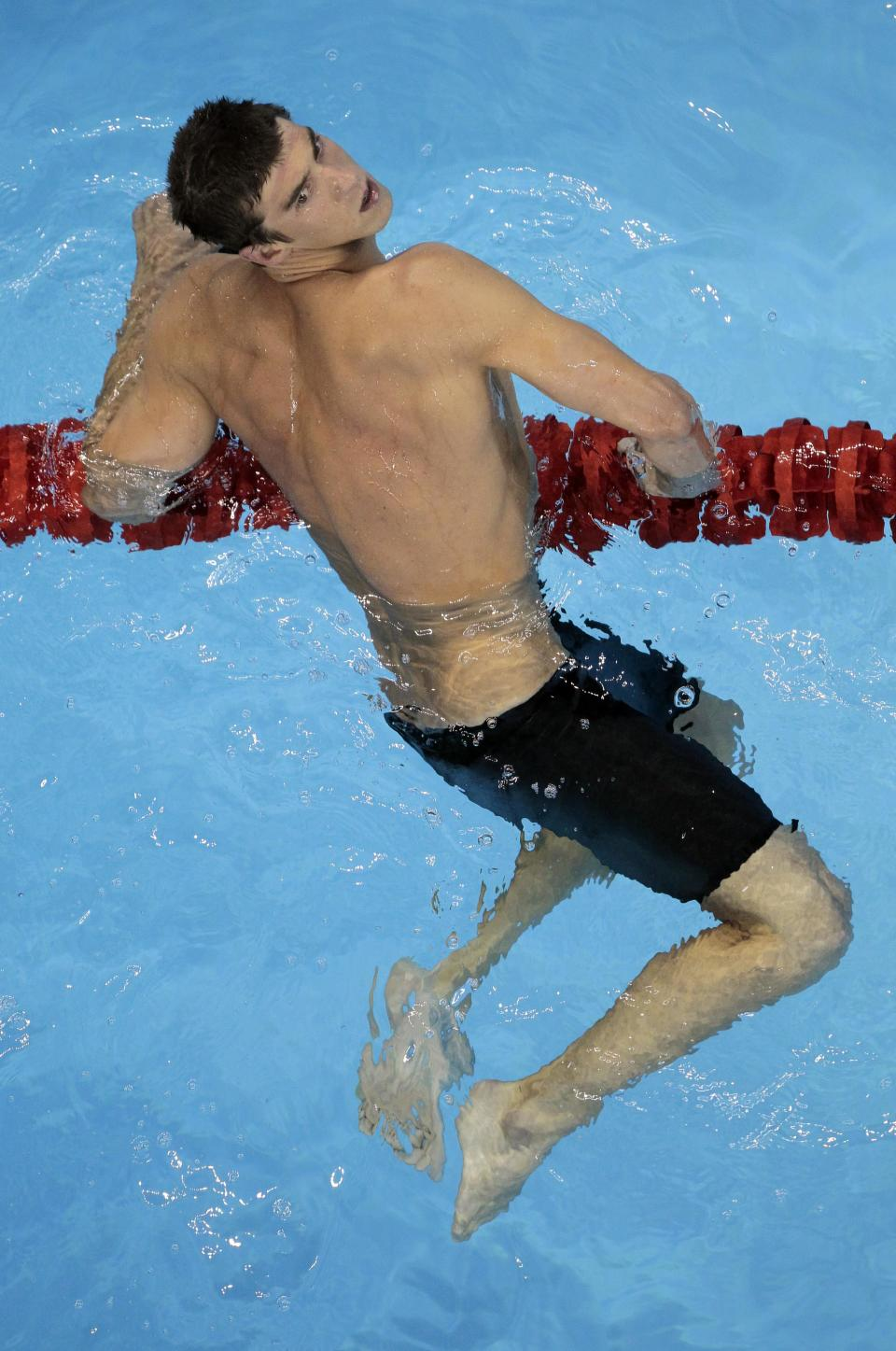 U.S. Michael Phelps rests after his race in the men's 200m Butterfly semifinals at the FINA Swimming World Championships in Shanghai, China, Tuesday, July 26, 2011. (AP Photo/Gero Breloer)
