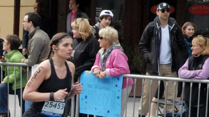 This Monday, April 15, 2013 photo provided by Bob Leonard shows second from right, Tamerlan Tsarnaev, who was dubbed Suspect No. 1 and walking behind him, Dzhokhar A. Tsarnaev, who was dubbed Suspect No. 2 in the Boston Marathon bombings by law enforcement. This image was taken approximately 10-20 minutes before the blast. (AP Photo/Bob Leonard)
