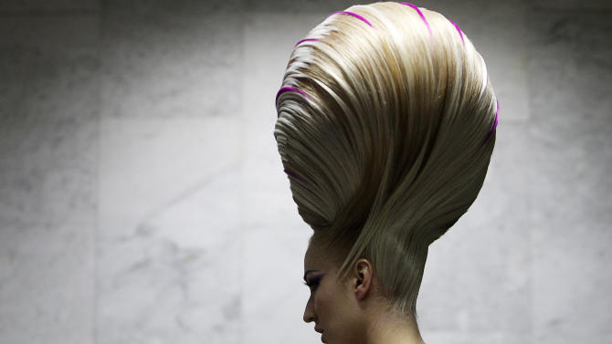 A model waits backstage before the Alternative Hair Show in Moscow?s Kremlin