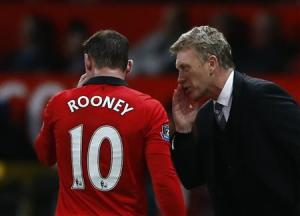 Manchester United's manager Moyes speaks to Rooney during their English Premier League soccer match against West Ham at Old Trafford in Manchester