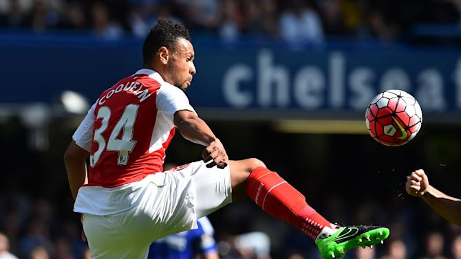 Arsenal's midfielder Francis Coquelin jumps for the ball during the English Premier League football match between Chelsea and Arsenal at Stamford Bridge in London on September 19, 2015