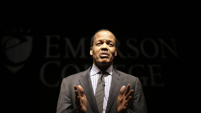 """In this Monday, Feb. 4, 2013 photo, Emerson College President Lee Pelton addresses an audience before the start of a public panel event called """"Made in America: Our Gun Violence Culture"""" at Emerson College in Boston. Pelton was driving home with his 13-year-old daughter in the passenger seat when radio reports of the Newtown school massacre forced him over to side of the road. """"I held her hand as we listened...and we both cried,"""" he said. (AP Photo/Steven Senne)"""