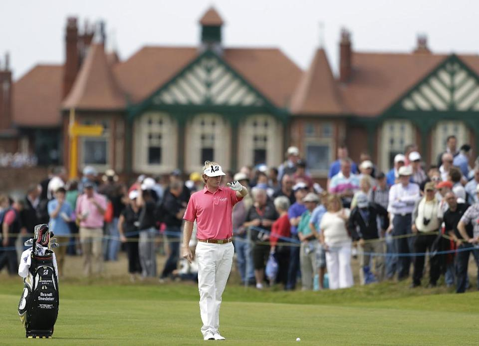 Brandt Snedeker of the United States prepares to play a shot on the second fairway at Royal Lytham & St Annes golf club during the third round of the British Open Golf Championship, Lytham St Annes, England, Saturday, July 21, 2012. (AP Photo/Peter Morrison)