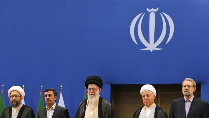 In this photo taken on Thursday, Aug. 30, 2012, and released by an official website of the Iranian supreme leader's office, supreme leader Ayatollah Ali Khamenei, center, parliament speaker Ali Larijani, right, chief of Expediency Council, Akbar Hashemi Rafsanjani, second right, President Mahmoud Ahmadinejad, second left, and judiciary chief Sadeq Larijani, left, listen to Iran's national anthem, at the opening session of the Nonaligned Movement, NAM, summit, in Tehran, Iran. (AP Photo/Office of the Supreme Leader)