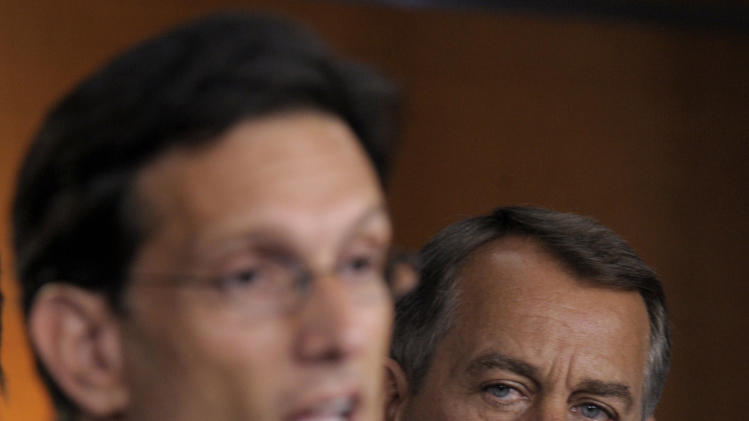 House Speaker John Boehner of Ohio, right, listens as House Majority Leader Eric Cantor, R-Va., left, speaks on Capitol Hill in Washington, Friday, July 15, 2011. (AP Photo/Susan Walsh)