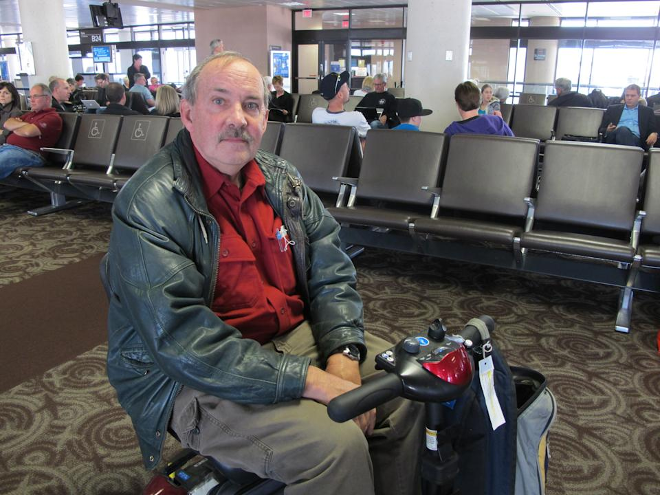 "John McConnell of St. Johns in Newfoundland, Canada, who was traveling through Phoenix on Wednesday after visiting his girlfriend in Tucson, said he underwent a ""humiliating"" pat-down at Phoenix Sky Harbor International Airport and that security agents took it too far. (AP Photo/Amanda Lee Myers)"
