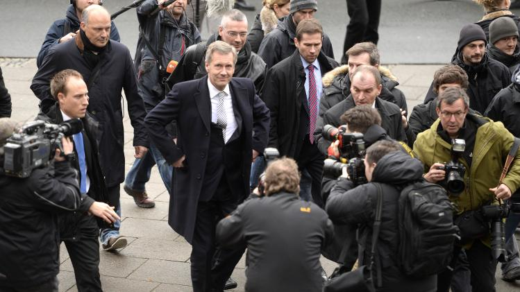 Former German President Wulff is surrounded by media as he arrives at the regional court in Hanover