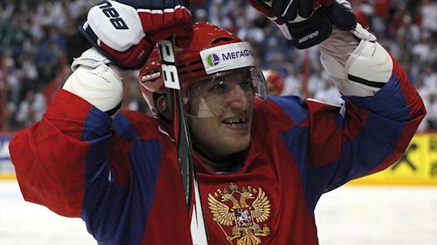 Russia's Alexander Ovechkin celebrates a goal of his teammate Pavel Datsyuk (not pictured) during their 2012 IIHF men's ice hockey World Championship final game against Slovakia in Helsinki (Reuters)