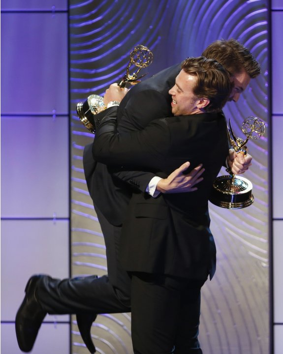 Actors Scott Clifton and Billy Miller celebrate both winning the award for outstanding supporting actor in a drama series award during the 40th annual Daytime Emmy Awards in Beverly Hills