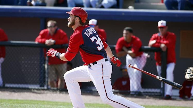 Washington Nationals left fielder Bryce Harper (34) bats in a spring exhibition baseball game against the Houston Astros, Friday, March 7, 2014, in Viera, Fla. The Nationals won 8-5. (AP Photo/Alex Brandon)