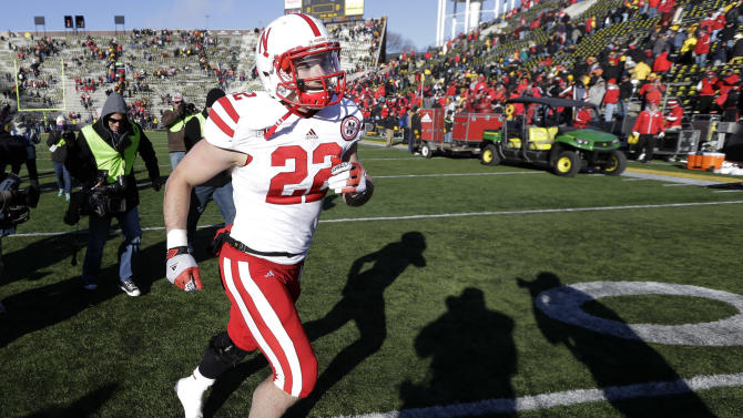 Nebraska running back Rex Burkhead runs off the field after their 13-7 victory over Iowa in an NCAA college football game, Friday, Nov. 23, 2012, in Iowa City, Iowa. (AP Photo/Charlie Neibergall)
