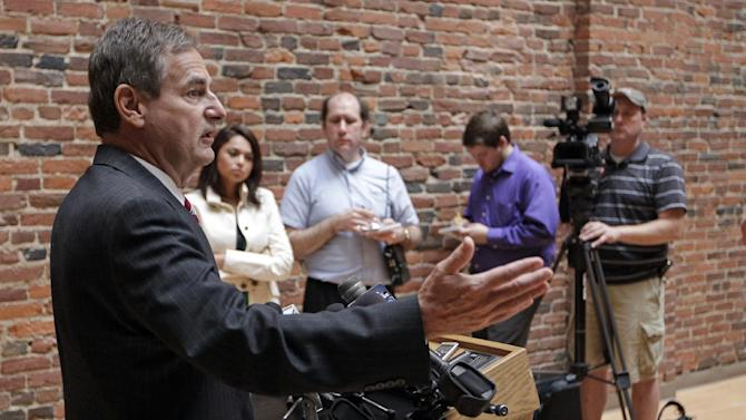 "Indiana Republican Senate candidate Richard Mourdock gestures during a news in Indianapolis, Wednesday, Oct. 24, 2012, to explain the comment he made during last night Senate debate. Mourdock said that when a woman becomes pregnant during a rape, ""that's something God intended."" Mourdock has been locked in a close contest with Democratic Rep. Joe Donnelly.   (AP Photo/Michael Conroy)"