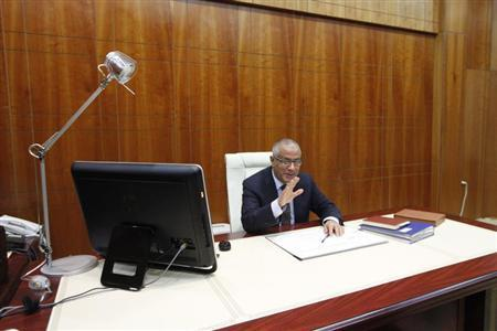 Libya's Prime Minister Ali Zeidan speaks during an interview with Reuters in Tripoli