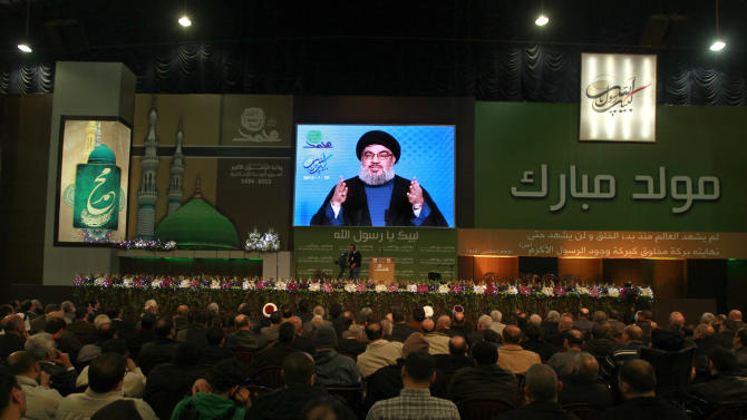 "Hezbollah leader Sheik Hassan Nasrallah speaks via a video link during a ceremony to mark Islam's Prophet Muhammad's birth in the southern suburb of Beirut, Lebanon, Friday, Jan. 25, 2013. Nasrallah, a staunch ally of the Syrian regime said those who had dreamed about ""dramatic changes"" taking place in Syria should let go of their dreams. He said all military, political and international indications showed that President Bashar Assad's regime cannot be defeated. (AP Photo/Bilal Hussein)"