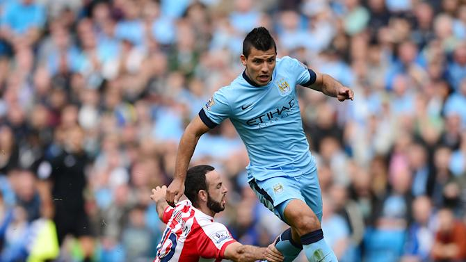 Manchester City's Argentine striker Sergio Aguero (R) vies with Stoke City's Republic of Ireland defender Marc Wilson during the English Premier League football match between Manchester City and Stoke City at the Etihad Stadium on August 30, 2014