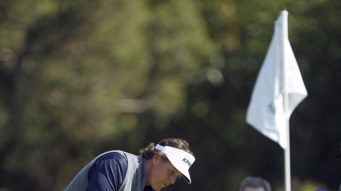 Phil Mickelson chips to the first green in the final round of the Northern Trust Open golf tournament at Riviera Country Club in Los Angeles, Sunday, Feb. 19, 2012. (AP Photo/Chris Carlson)