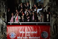 MUNICH, GERMANY - MAY 11: Head coach Jupp Heynckes of Bayern Muenchen and his team celebrate with the trophy the German championship title on the town hall balcony at Marienplatz on May 11, 2013 in Munich, Germany.  (Photo by Lars Baron/Bongarts/Getty Images)