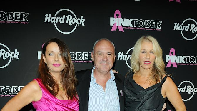 Keren Woodward, on left, and Sara Dallin, on right, of Bananarama with Hamish Dodds, CEO of Hard Rock International, arrive at the 13th Annual Pinktober Breast Cancer Awareness Campaign, on Tuesday, Oct. 2, 2012 at Hard Rock Cafe, New York. (Photo by Scott Gries/Invision for Hard Rock/AP Images)